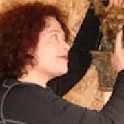 Julie Ann and her garden gargoyle Argyle